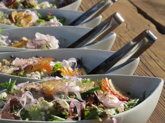 "White balsamic-vinegar ""pearls"" garnish a salad of local greens, stone fruit and shaved radishes by Alex Montoya, executive pastry chef at Calamigos Ranch in Malibu. The family-style dish was served as the first course at the From Field to Fork dinner benefiting House Farm Workers!, a Santa Paula-based nonprofit."
