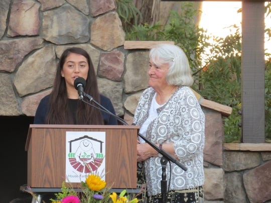 Recent Fillmore High School graduate Marlen Garcia Cano, left, addresses the crowd after receiving a scholarship created for the college-bound children of farmworkers who live in Ventura County. The scholarship is named for Ellen Brokaw, right, the founding chair of House Farm Workers!, a nonprofit based in Santa Paula.