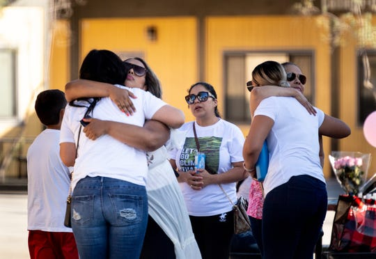 Family and friends gather at Ace Empower Academy to remember Keyla Salazar, one of the victims of the shooting at the 2019 Gilroy Garlic Festival on Sunday.