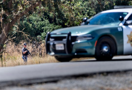 Law enforcement officers from multiple agencies continue to search the scene on Monday, July 29, 2019 where four people were killed and another 15 injured during the Gilroy Garlic Festival. The shooting was reported around 5:41 p.m. on Sunday near the north side of the festival.