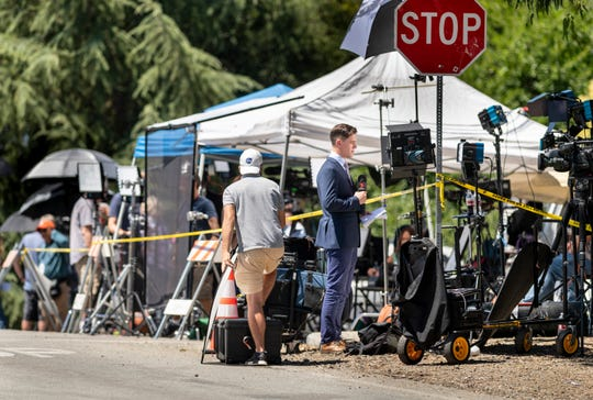 Media outlets converge on the corner of Uvas Park Drive and Miller Avenue on Monday after Sunday's shooting at the Gilroy Garlic Festival. Miller Avenue into Christmas Hill Park is still closed as law enforcement continues the investigation.
