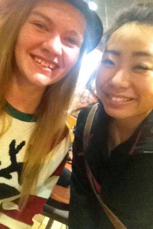 Laile Vang, right, was killed Sunday night after a man police say she didn't know shot her at her parents' home in Lake Hallie.