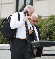 Hector May, right, facing 20 years in prison and $19-million in penalties for stealing millions from investors, with attorney Kevin Conway, left, enters the U.S. District Courthouse in White Plains for sentencing on Wednesday, July 31, 2019.