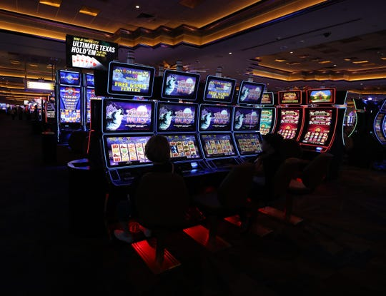 Patrons play video slot machines at Empire City Casino by MGM Resorts in Yonkers, July 31, 2019.