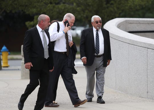 Hector May, right, enters U.S. District Courthouse in White Plains for sentencing, Wednesday, July 31, 2019.  May ripped off $11 million from investors in what federal prosecutors called a 25-year Ponzi scheme.