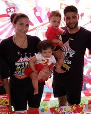 Marissa Rodriguez and Juan Rodriguez with twins Luna and Phoenix.