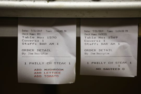 James Pappas' order slip hangs in the kitchen at James Street Tavern in Newport on Wednesday, July 21, 2019. He's ordered the same meal over 300 times in the past year.