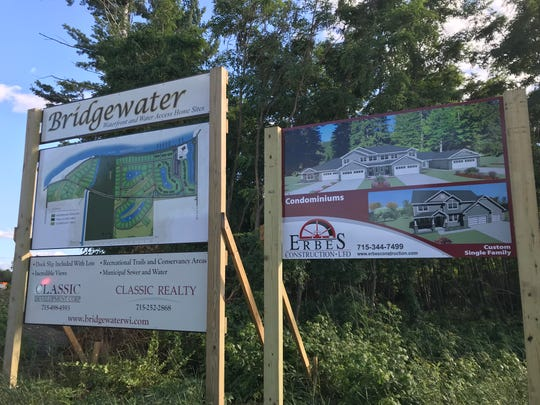 Signs show future plans for the Bridgewater project near Anchor Bay Bar & Grill in Biron.