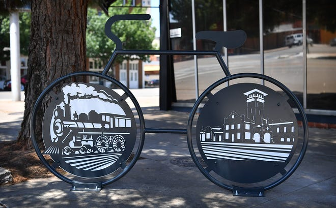 A steam locomotive and the former railroad depot are depicted in the newest sculptural bike rack installed recently near the corner of 7th Street and Ohio Avenue.