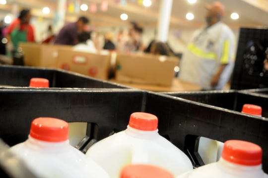 The USDA began delivering milk in half gallons, but switched to full gallons, which present a challenge for food pantries and recipients, many of whom rely on public transportation.