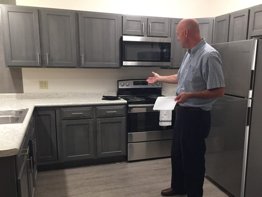 Dan Carpenetti of Allwell shows a model apartment at Llewellyn Suites. Each of the nine apartments has an open floor plan with a living and dining area, as well as a bedroom and bathroom. A laundry facility and common area are provided as well.