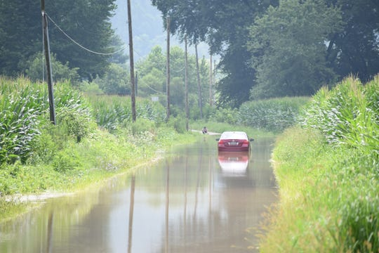 School House Road flooded due to heavy rain in the Dresden area Tuesday night and Wednesday morning.