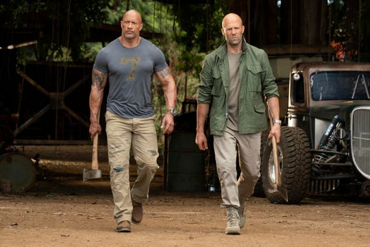 "Luke Hobbs (Dwayne Johnson, left) and Deckard Shaw (Jason Statham) are frenemies on a new mission in ""Fast & Furious Presents: Hobbs & Shaw."""