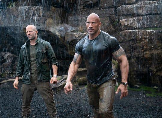 "Deckard Shaw (Jason Statham, left) and Luke Hobbs (Dwayne Johnson) face a genetically enhanced villain in ""Hobbs & Shaw."""