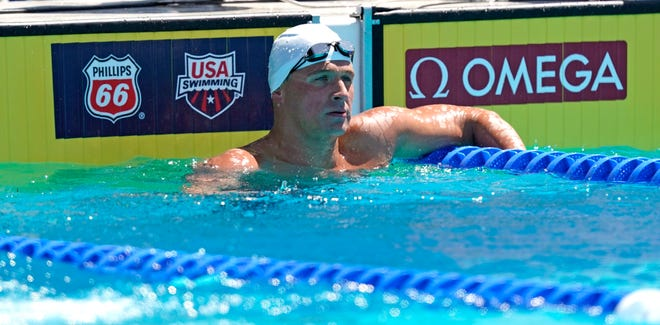 Ryan Lochte looks at his time after the 200-meter individual medley time trial at the U.S. national swimming championships.