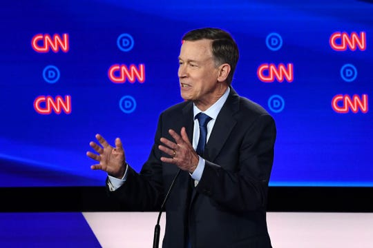Democratic presidential hopeful Former Governor of Colorado John Hickenlooper gestures as he speaks during the first round of the second Democratic primary debate.