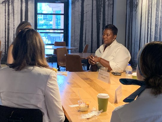 Cincinnati council member Tamaya Dennard speaks with with a group of real estate and development industry professionals on July 30, 2019.