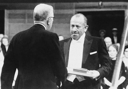 American Author John Steinbeck, right, receiving the Nobel Prize for Literature from King Gustav during Award Ceremonies in Stockholm's Concert Hall in Sweden.