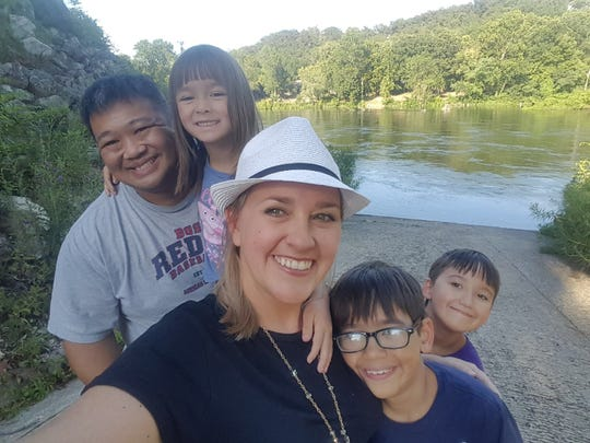 Amanda Wen, a 39-year-old mother and writer takes a selfie with her 41-year-old husband Cheech Wen and their three children on a road trip from their Wichita, Kansas home to Branson, Missouri. Wen says that she likes to take advantage of unscheduled downtime during summer breaks for her children with family trips, bike rides and swimming.
