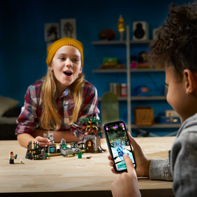 The physical fuses with the virtual in LEGO Hidden Side, a collection of LEGO playsets like Graveyard Mystery ($29.99) that works with an augmented reality app.