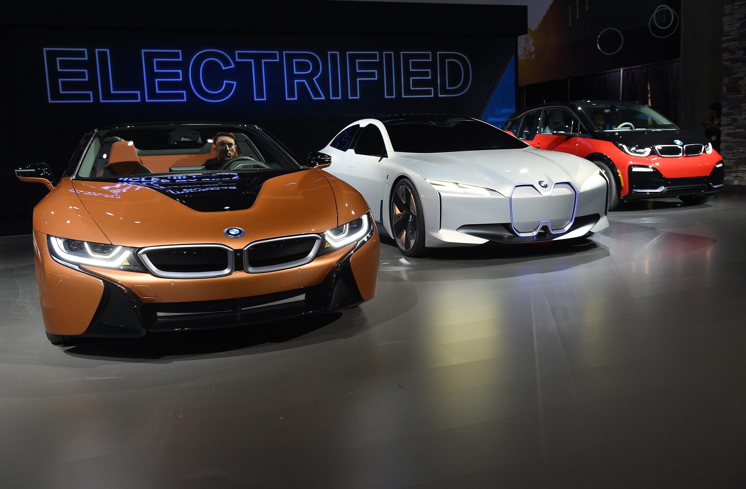 2019 BMW i8 Roadster (left)