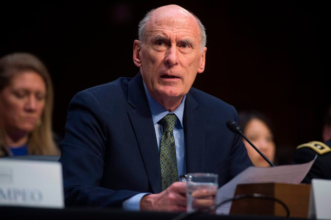 """(FILES) In this file photo taken on February 13, 2018 Director of National Intelligence Dan Coats testifies on worldwide threats during a Senate Intelligence Committee hearing on Capitol Hill in Washington, DC. - US intelligence chief Dan Coats will leave office on August 15, President Donald Trump announced on July 28, 2019, the latest high-profile departure from his turnover-plagued administration.Trump tweeted that he plans to nominate Congressman John Ratcliffe of Texas as the new Director of National Intelligence, and thanked Coats """"for his great service to our Country."""" (Photo by SAUL LOEB / AFP)SAUL LOEB/AFP/Getty Images ORIG FILE ID: AFP_1J64KM"""