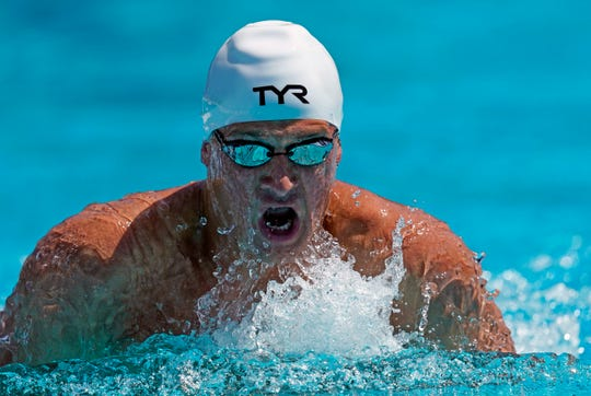 Ryan Lochte competes in the men's 200-meter individual medley time trial at the U.S. national swimming championships in Stanford, Calif.,  July 31, 2019. Lochte is returning from a 14-month suspension. (AP Photo/David J. Phillip)