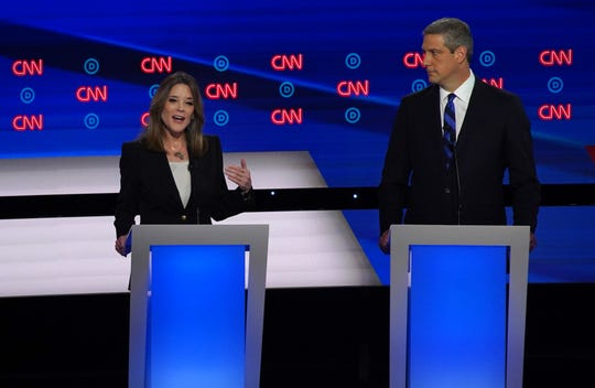 Candidate Marianne Williamson (left) speaks during the first night of the Democratic presidential debates at the Fox Theatre in Detroit on Tuesday, July 30, 2019.