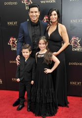 Mario Lopez,with his wife, Courtney Laine Mazza, and two of their children, Dominic and Gia, arrive at the Daytime Emmy Awards on May 5, 2019, in Pasadena, Calif.