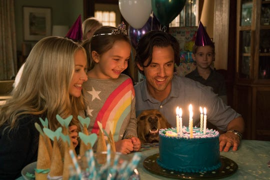 """Enzo's family celebrates the birthday of little girl Zoe (Ryan Kiera Armstrong) in """"The Art of Racing in the Rain."""""""