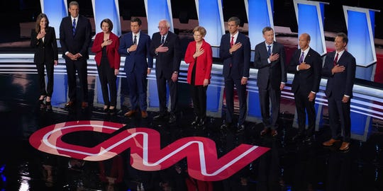 Candidates on stage during the National Anthem before the start of the first night of the Democratic presidential debates at the Fox Theatre in Detroit on  July 30, 2019.