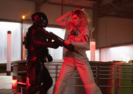 "Hattie Shaw (Vanessa Kirby) tussles with a helmeted goon in ""Hobbs & Shaw."""