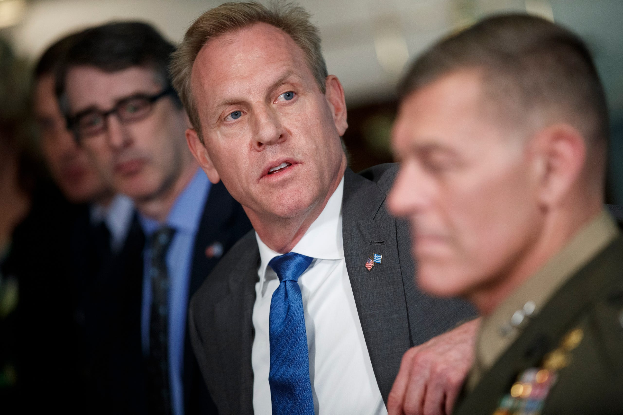 """Acting Secretary of Defense Patrick Shanahan (C) delivers remarks during a meeting with Greek Minister of Defense Evangelos Apostolakis at the Pentagon on June 7, 2019.In a June 18 tweet, the president saidShanahan did """"a wonderful job"""" but wanted to """"devote more time to his family."""" The announcement came about an hour after USA TODAYdetailedan FBI examination of a 2010 violent domestic disputebetween Shanahan and his then-wife."""