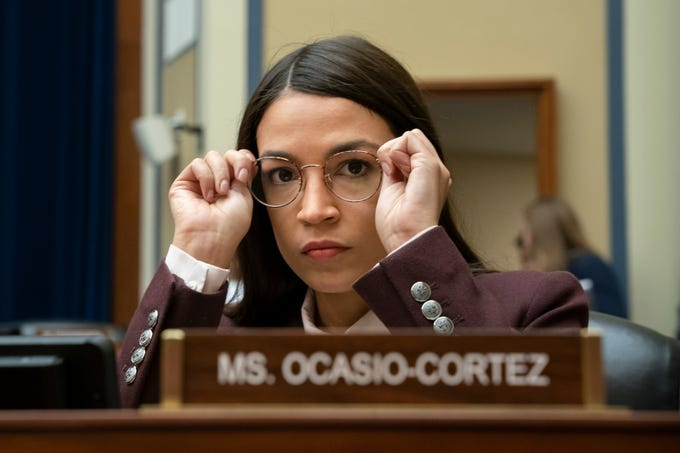 Rep. Alexandria Ocasio-Cortez, D-N.Y., attends a House Oversight Committee hearing on high prescription drugs prices shortly after her private meeting with Speaker of the House Nancy Pelosi, D-Calif., on Capitol Hill in Washington, July 26, 2019. The high-profile freshman and the veteran Pelosi have been critical of one another recently.