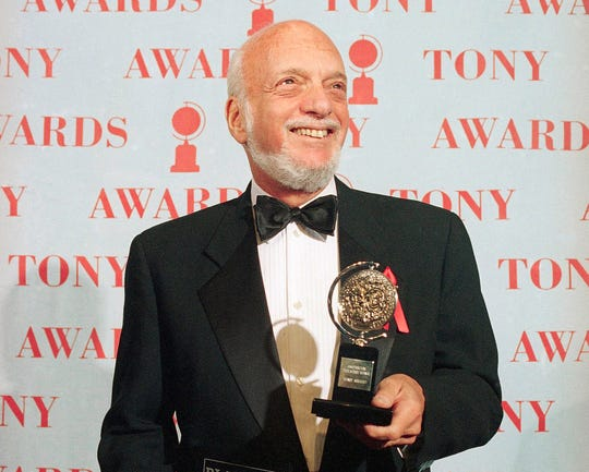 "In this June 4, 1995 file photo, Hal Prince holds his Tony award for best director in a musical for ""Show Boat,"" at Broadway's Minskoff Theater in New York on June 4, 1995."