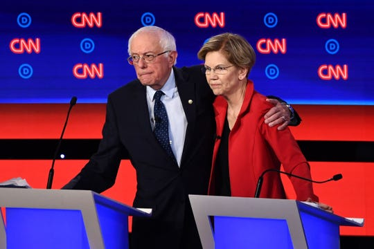 Democratic presidential candidates Bernie Sanders and Elizabeth Warren hug after participating in the first round of the second Democratic primary debate of the 2020 presidential campaign season hosted by CNN at the Fox Theatre in Detroit, Michigan on July 30, 2019.