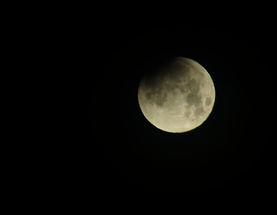A partially eclipsed supermoon sets in Clarksville on Jan. 31, 2018.
