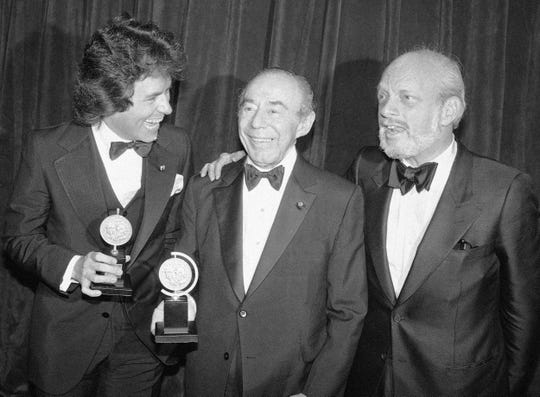 FILE - In this June 4, 1979 file photo, Jack Hofsiss, left, and Hal Prince, right, flank Richard Rodgers at the Tony Award presentations in New York in June 1979.