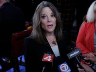 Marianne Williamson talks to reporters after the first of two Democratic presidential primary debates hosted by CNN, July 30, 2019, in the Fox Theatre in Detroit.