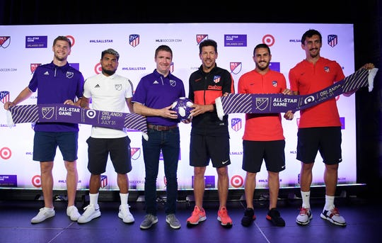 (From left) Walker Zimmerman, Josef Martinez, head coach James O'Connor, Athletico Madrid manager Diego Simeone, Koke and Stefan Savic pose for a photo during a press conference for the MLS All Star Game.