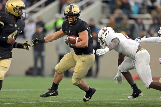 Army running back Connor Slomka carries the ball against Lafayette during their team's game in 2018.