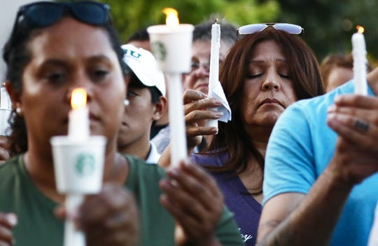 People attend a vigil for victims of the mass shooting at the Gilroy Garlic Festival on July 29, 2019, in Gilroy, Calif. Three people were killed and at least a dozen wounded yesterday before police officers shot and killed the suspect.