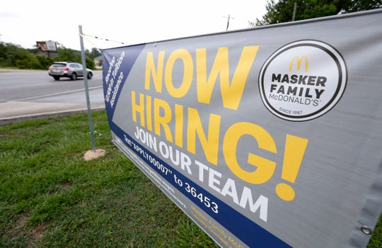 FILE - In this June 21, 2019, file photo a now hiring sign is displayed to attract potential workers at a McDonald's restaurant in Moss Point, Miss. On Wednesday, July 31, payroll processor ADP  reports on how many jobs its survey estimates U.S. companies added in July. (AP Photo/Rogelio V. Solis, File)