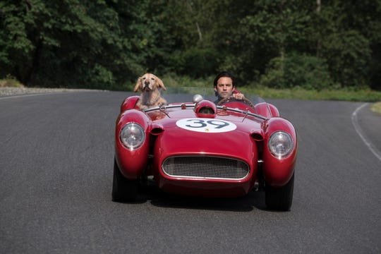 Enzo is a race-car driver at heart. Here, he gets a joy ride with Denny (Milo Ventimiglia).