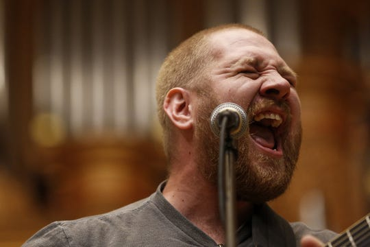Travis Gray of Wild Adriatic from Glens Falls, N.Y., sings at Lawrence Chapel during the first day of the seventh annual Mile of Music festival on August 1, 2019 in Appleton, Wis.