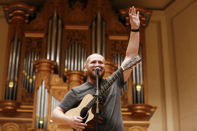 Travis Gray of Wild Adriatic waves to the crowd at the Lawrence Memorial Chapel during Mile of Music's opening day Thursday.