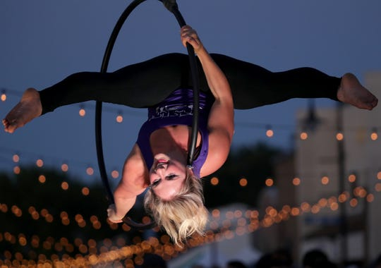 Fly Circus & Aerial Arts provided performers for the recent Bazaar After Dark in Little Chute. The business holds a grand opening today in its new Appleton location.