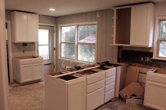 Cabinets have been placed and hung in the kitchen, with molding, countertops and flooring still to come.
