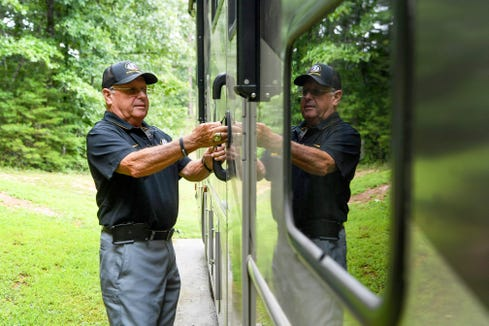 A 30-foot RV has been parked almost permanently in the driveway of David Gentry's Murphy home since he and his wife Kelly bought it two years ago. Retirement plans to travel cross country have been put on hold while Gentry continues a football coaching career that started more than 50 years ago.