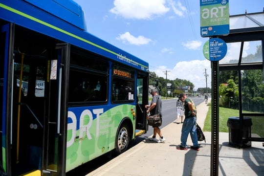 People board an Asheville Redefines Transit bus July 19, 2019.